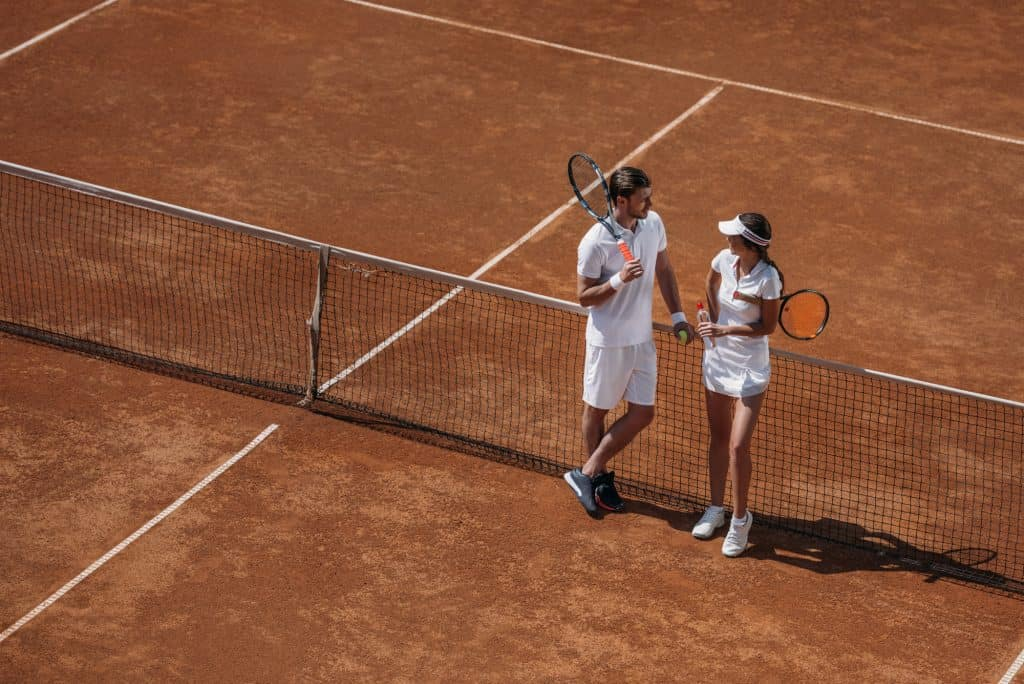 Couple At A Tennis Court