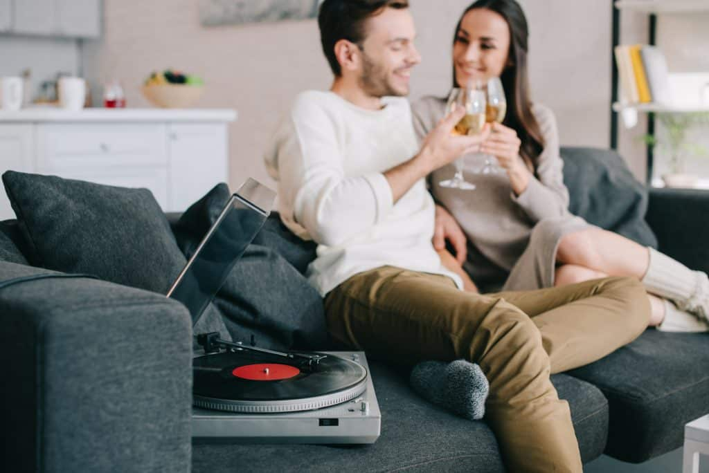 Couple Drinking Wine Listening To Music