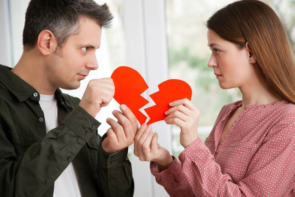 Couple Holding A Heartbroken Card