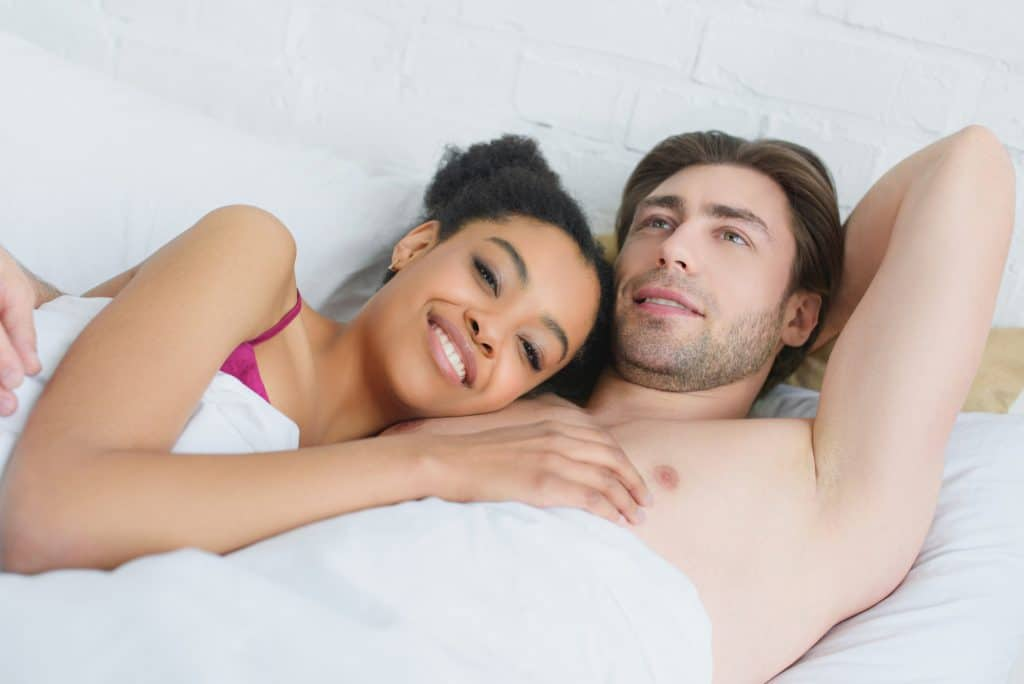 Couple In Bed Relaxing