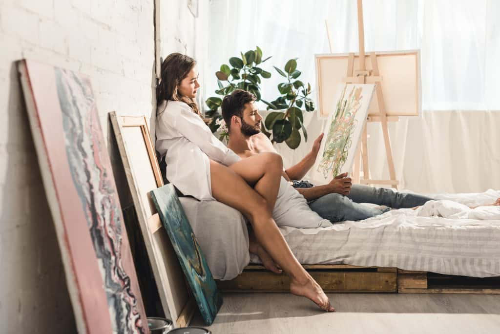 Couple Looking At A Painting