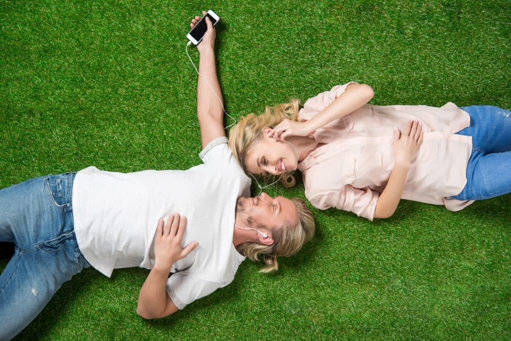Couple Lying Down Listening To Music