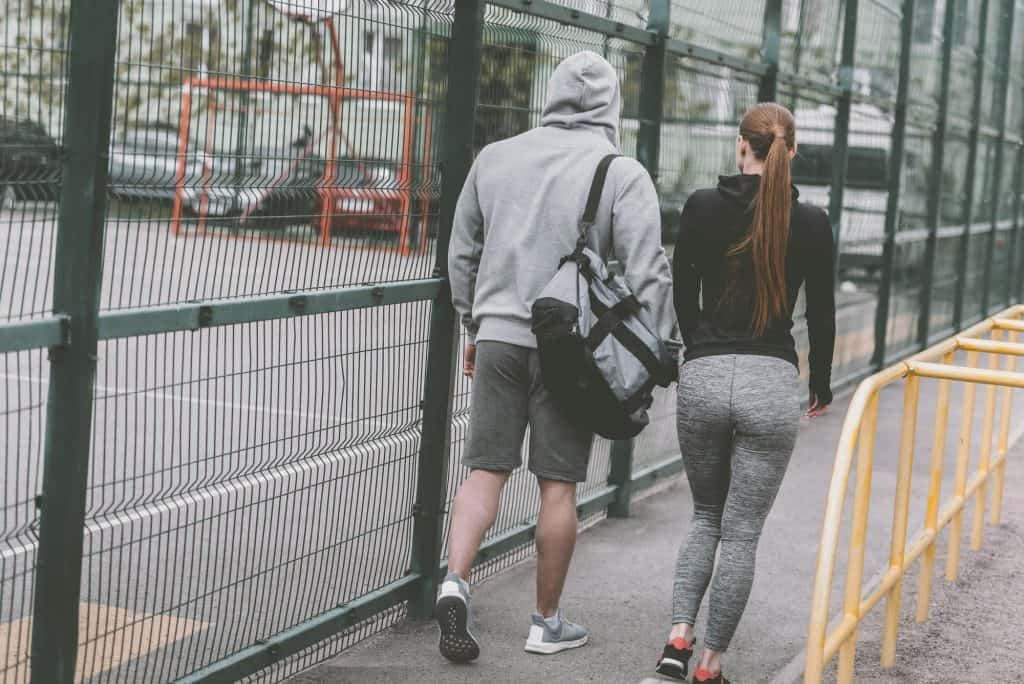Couple Walking After A Workout