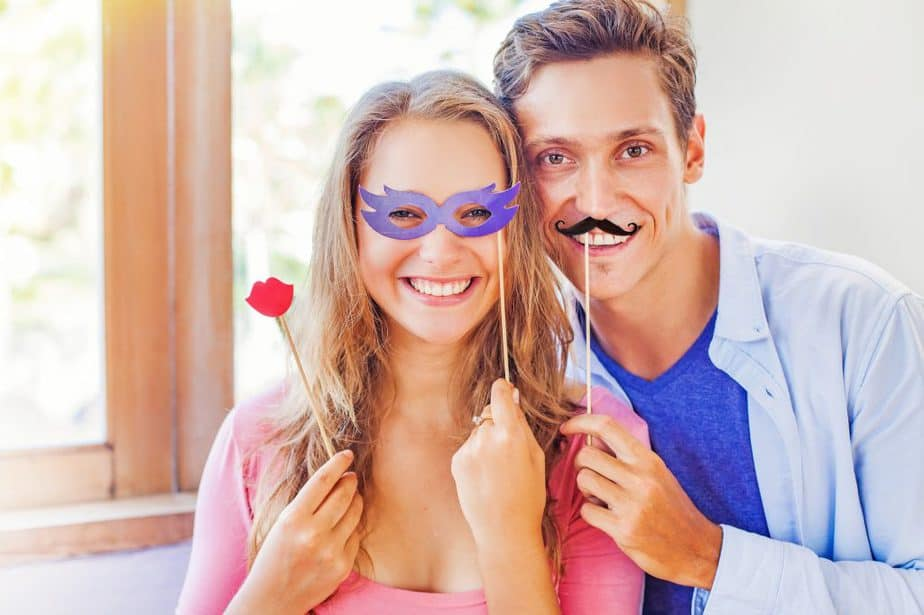 Cute Couple Posing With Masks