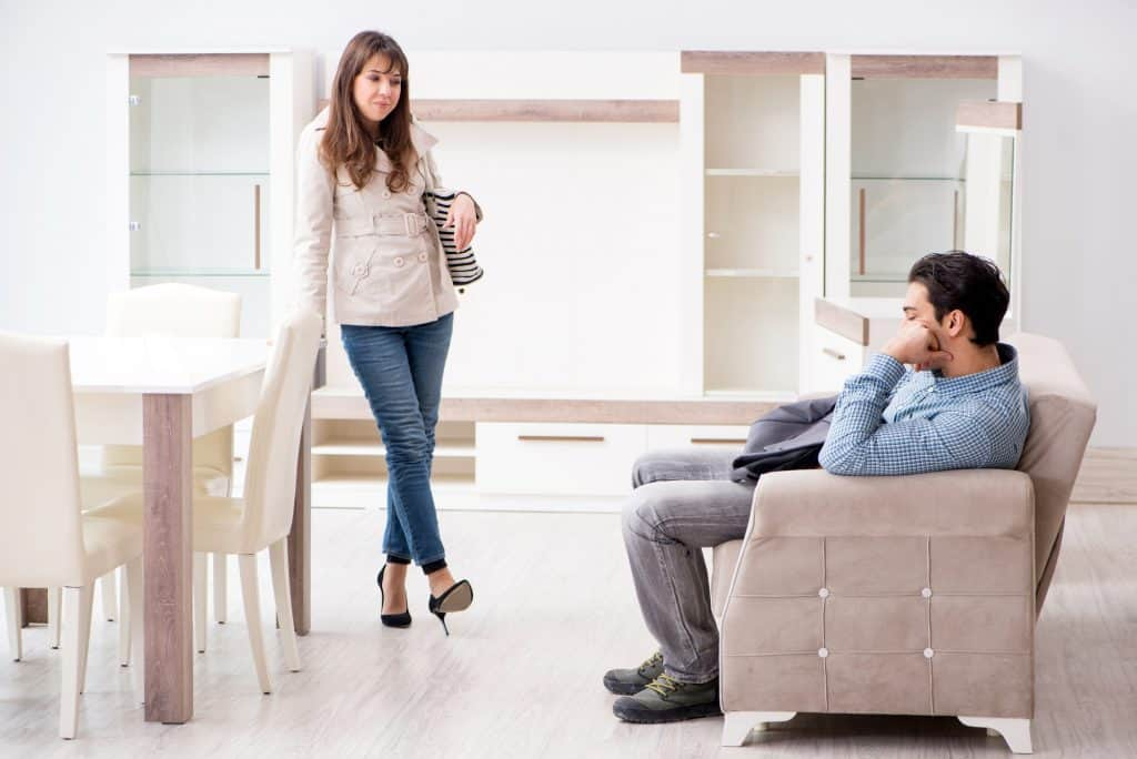 Man Bored While Furniture Shopping With Wife