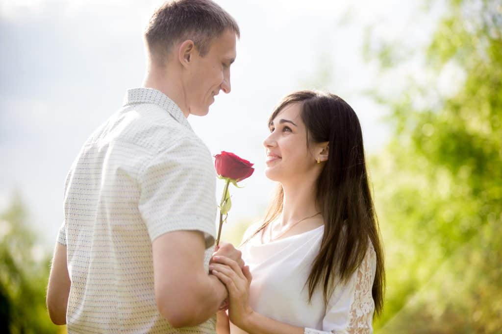 Man Giving A Flower To His Girlfriend