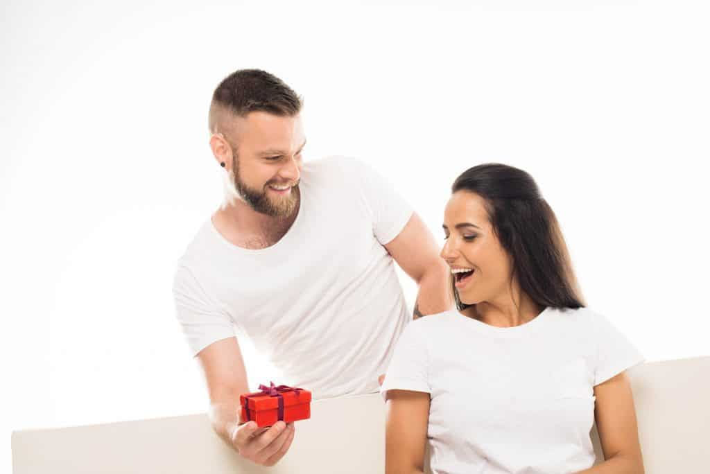 Man Giving A Present To His Girlfriend