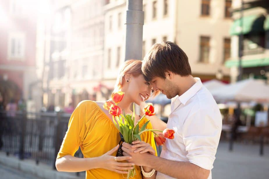Man Giving Flower To A Woman