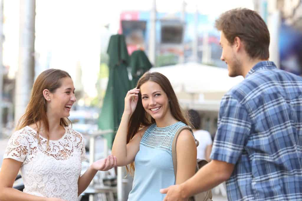 Man Introducing Girlfriend To A Friend