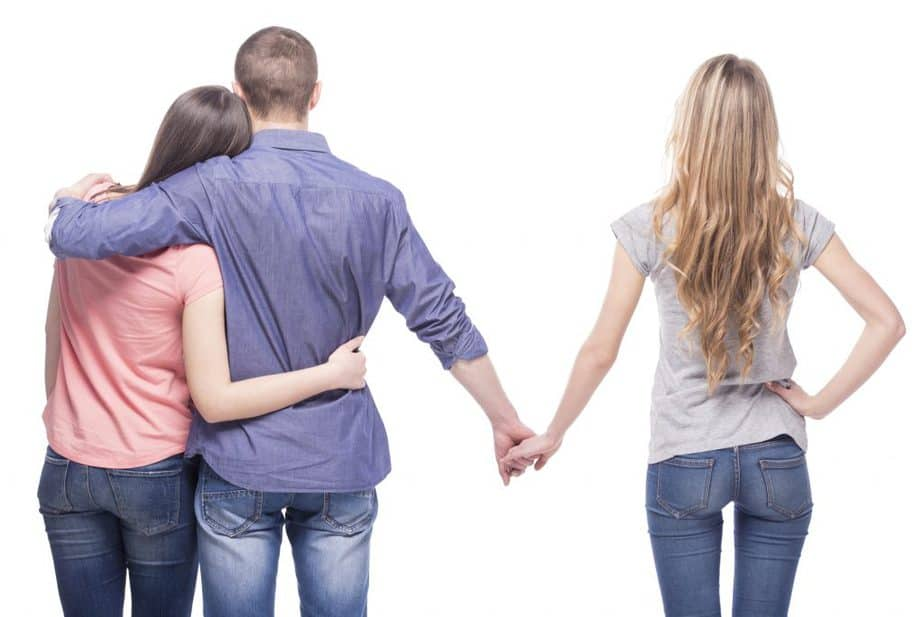 Man With Girlfriend Holding Another Woman's Hand