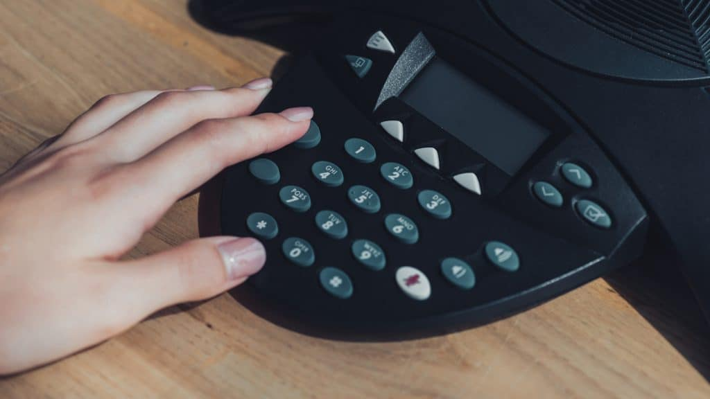 Photo Of Hand Dialling On Phone
