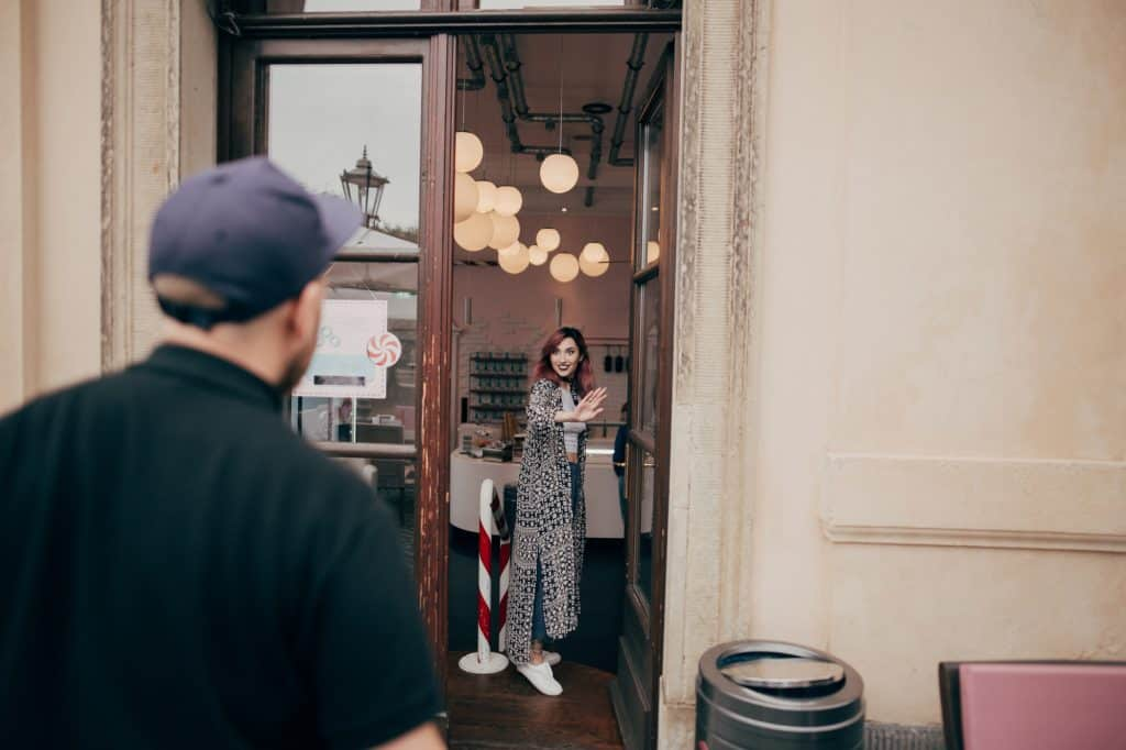 Woman In A Cafe Looking At The Man Outside