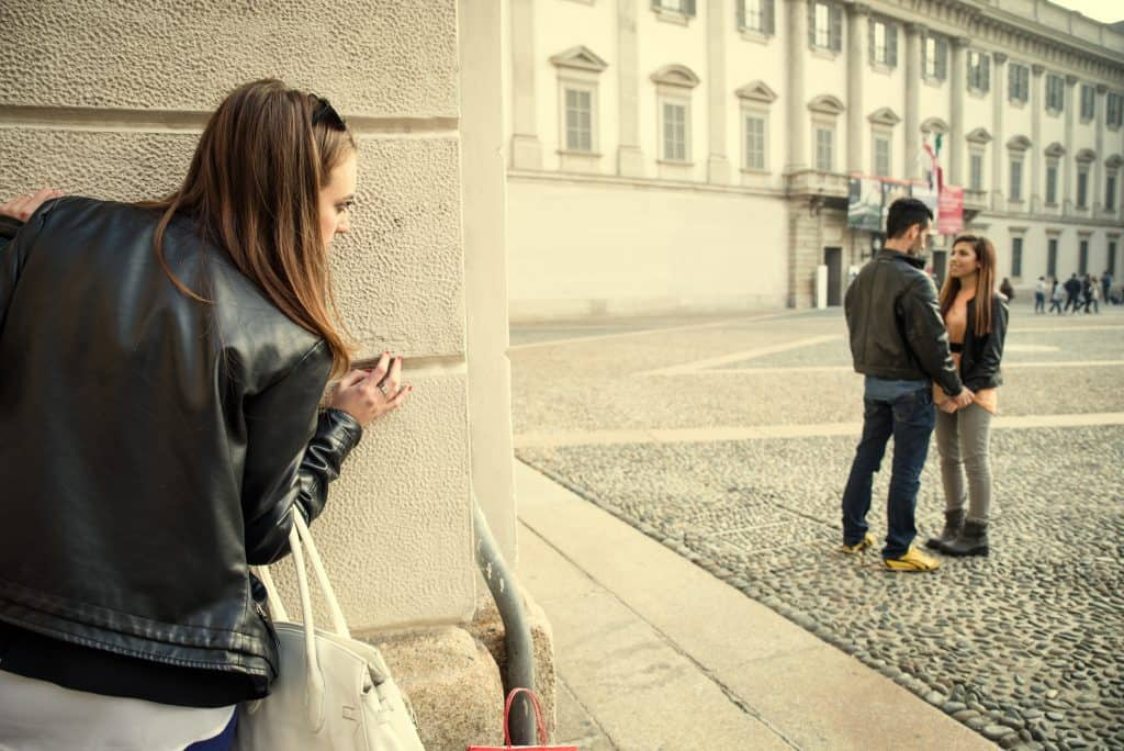Woman Looking At A Couple From A Distance