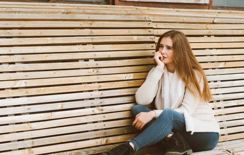 Woman On A Bench Wondering