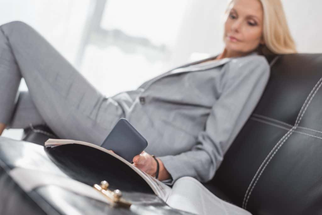 Businesswoman Sitting Holding Her Phone
