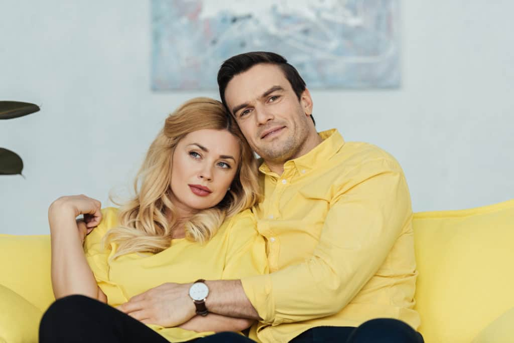 Couple On A Sofa Wearing The Same Color