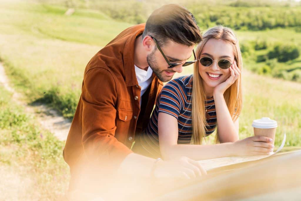 Couple Outdoors Looking At A Map