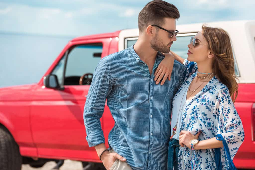 Couple With Truck In Background