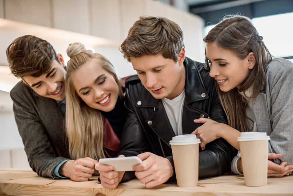 Group Of Friends Looking At A Phone