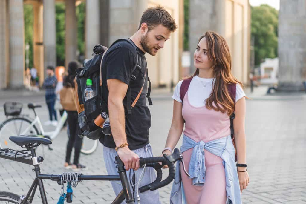 Man Holding His Bike With His Girlfriend