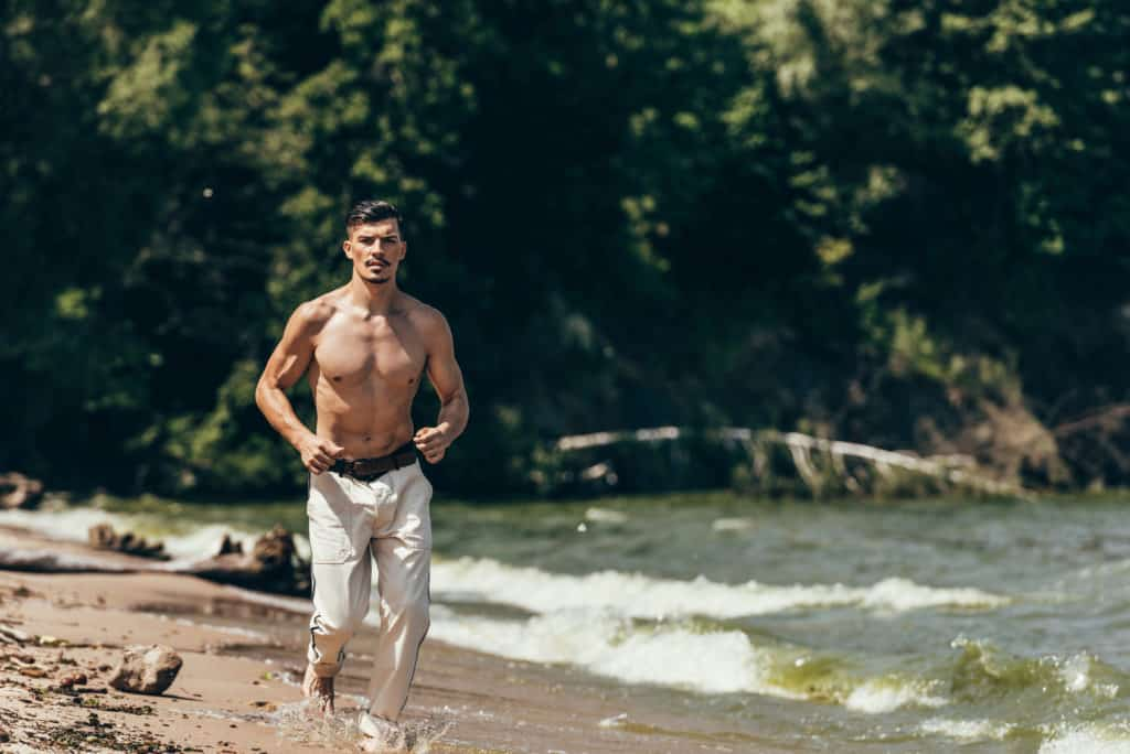 Man Jogging By The Shore