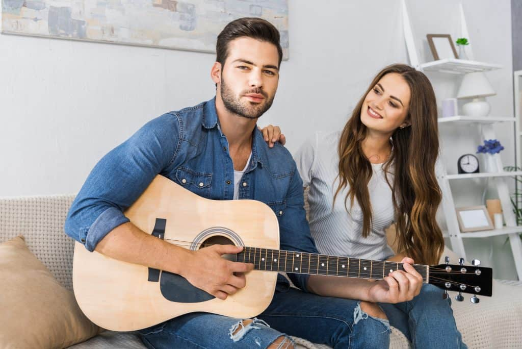 Man Playing His Guitar With His Girlfriend