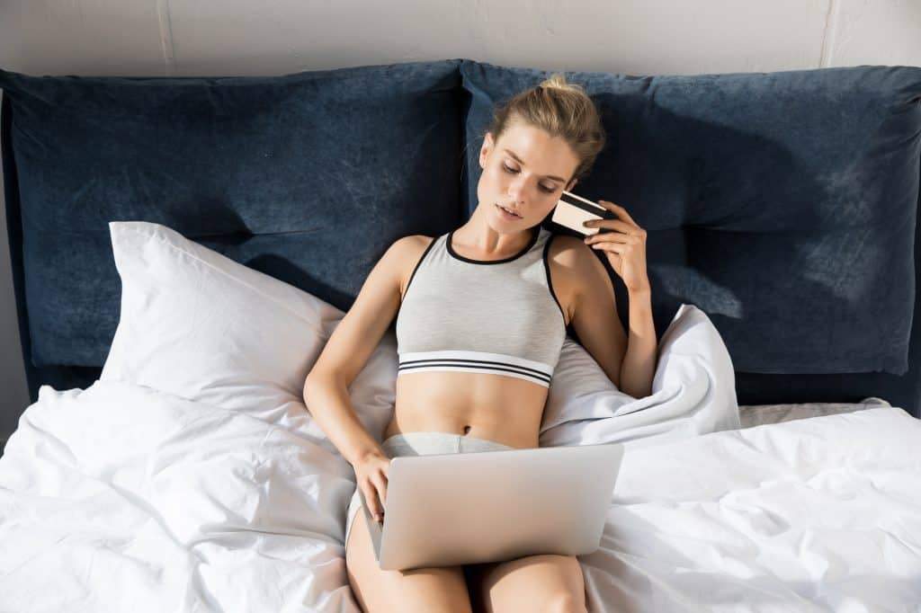 Woman In Bed In Her Underwear With Her Laptop