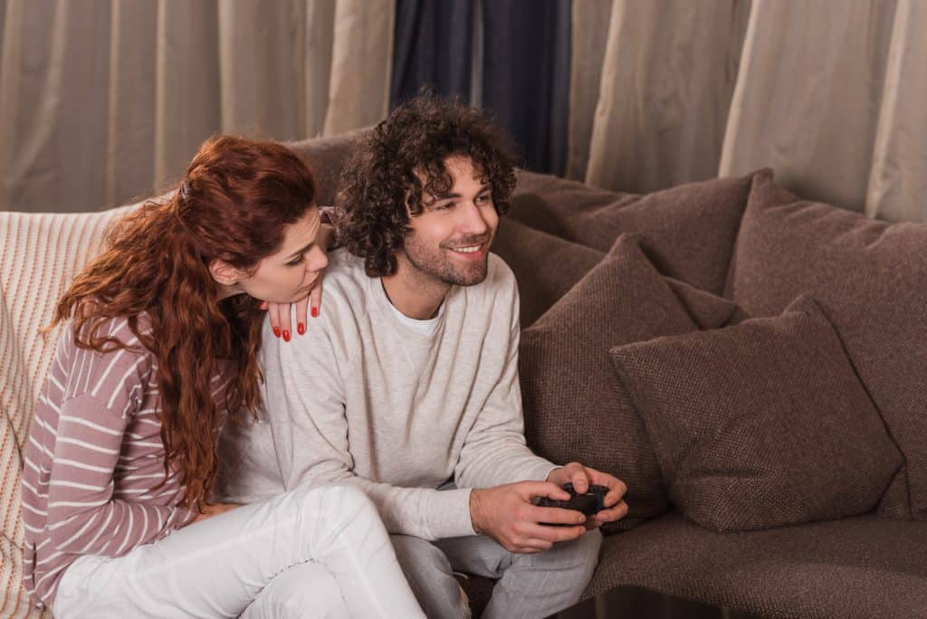 Woman With A Man Playing Games