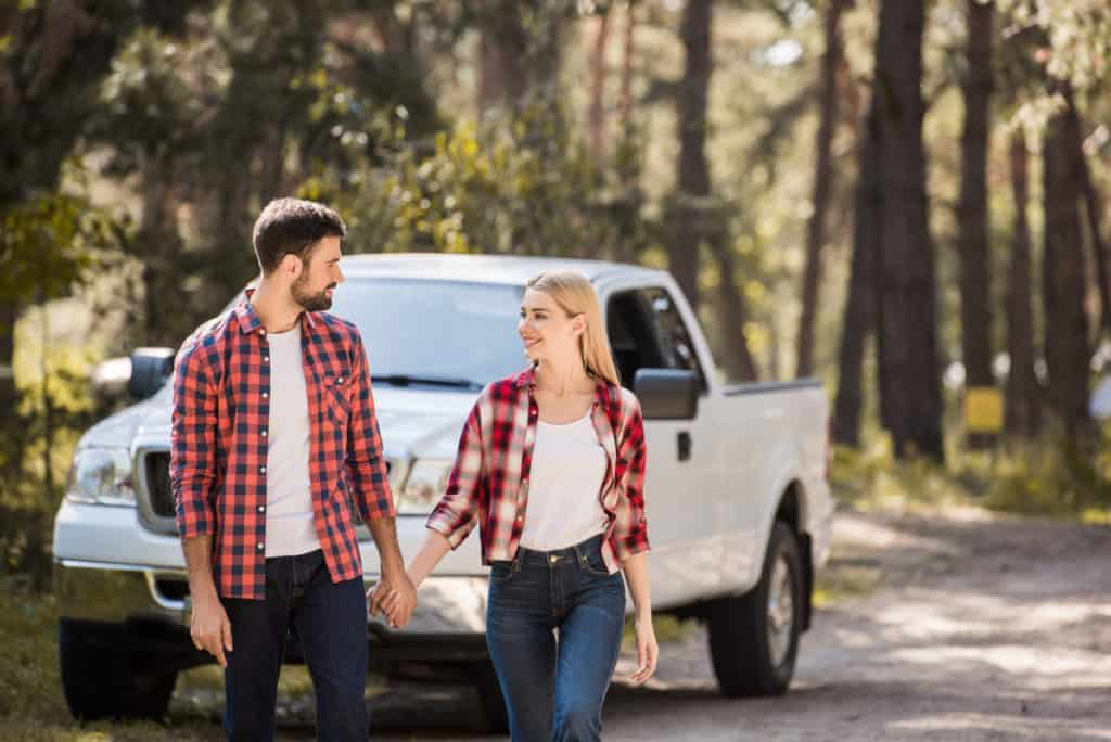Couple Walking Away From Car