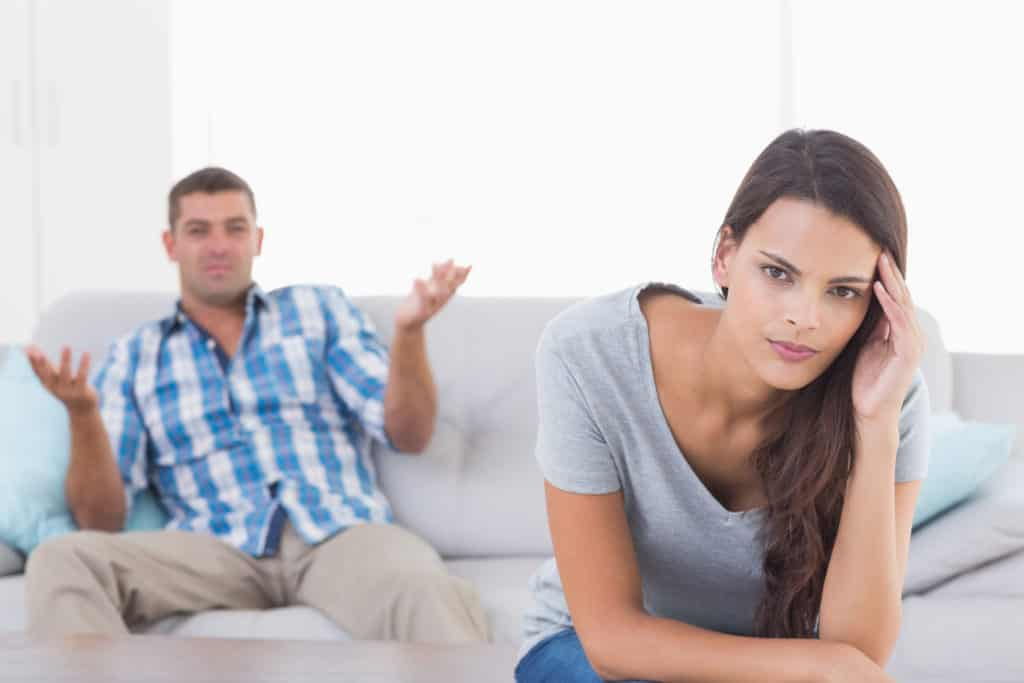 Man On The Sofa Arguing With Wife