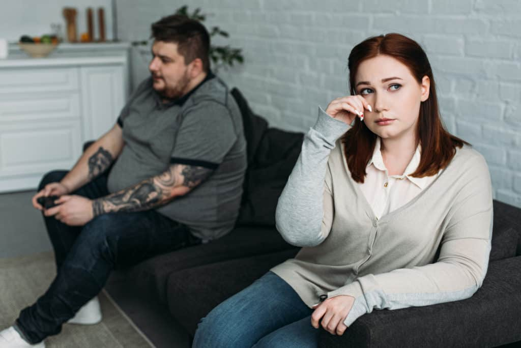 Woman Crying Man Playing Console